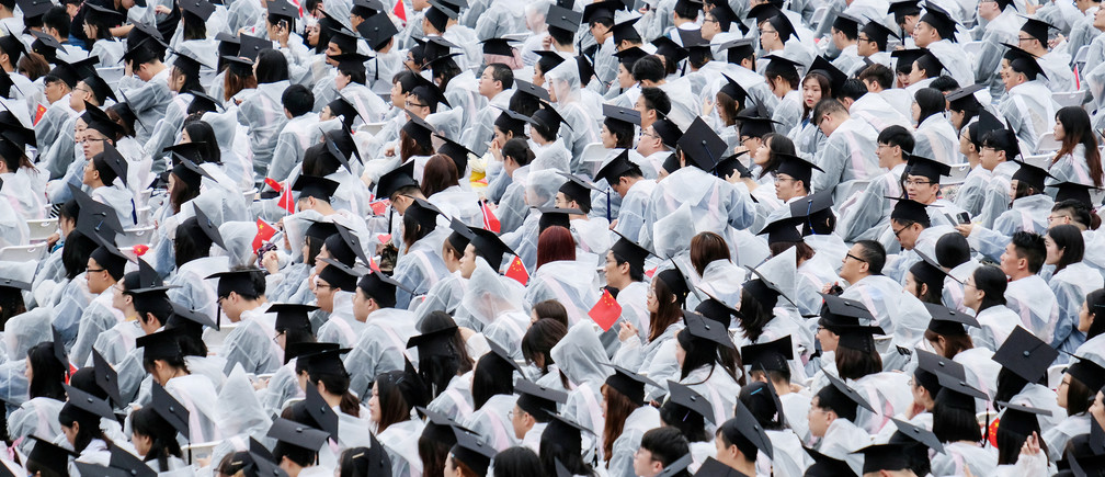 Students wearing raincoats attend their graduation ceremony at Wuhan University in Wuhan, Hubei province, China June 21, 2019. REUTERS/Stringer  ATTENTION EDITORS - THIS IMAGE WAS PROVIDED BY A THIRD PARTY. CHINA OUT.     TPX IMAGES OF THE DAY - RC19E9D19630