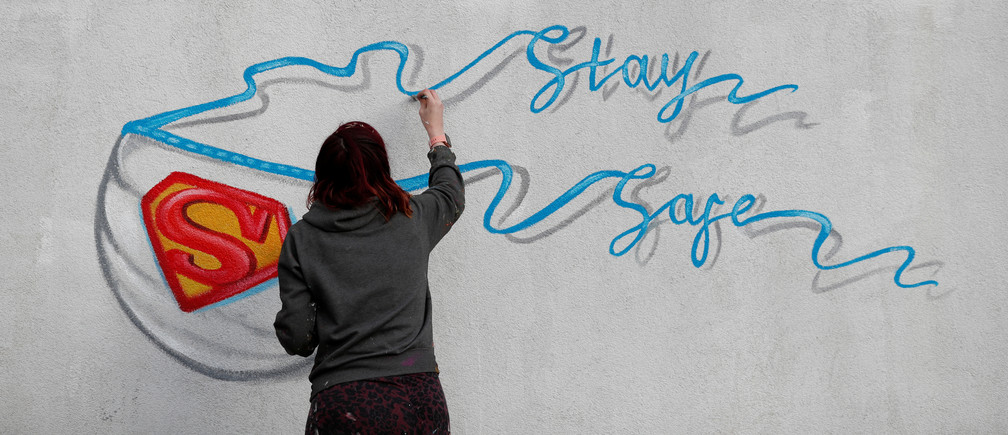 Artist Rachel List paints a mural, as the spread of the coronavirus disease (COVID-19) continues, in Pontefract, Britain, April 6, 2020. REUTERS/Lee Smith     TPX IMAGES OF THE DAY - RC2WYF9SJJ37