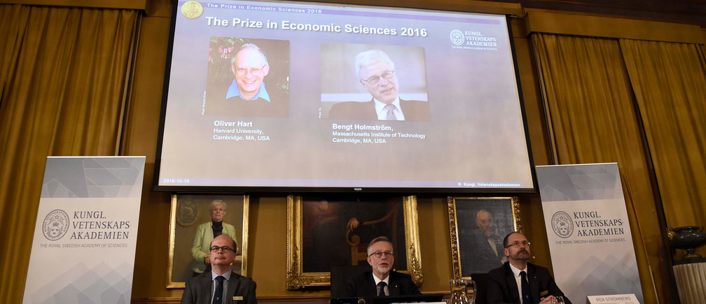 Tomas Sjostrom, member of the Committee for the Prize in Economic Sciences in Memory of Alfred Nobel, Goran K. Hansson, Secretary General of the Royal Swedish Academy of Sciences and Per Stromberg, Chairman of of the Committee for the Prize in Economic Sciences in Memory of Alfred Nobel, during a news conference presenting the laureates for the Sveriges Riksbank Prize in Economic Sciences in Memory of Alfred Nobel 2016: Oliver Hart and Bengt Holmstrom, in Stockholm, Sweden, October 10, 2016.