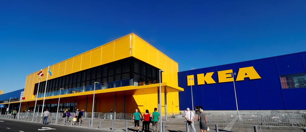 People walk past an IKEA sign as they visit the company's new store in Riga, Latvia September 2, 2018. REUTERS/Ints Kalnins - RC1CE9F7A530