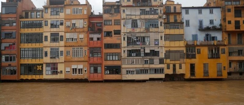 "Houses are seen on the Onyar river during the storm ""Gloria"" in Girona, Spain, January 22, 2020. REUTERS/Nacho Doce -"