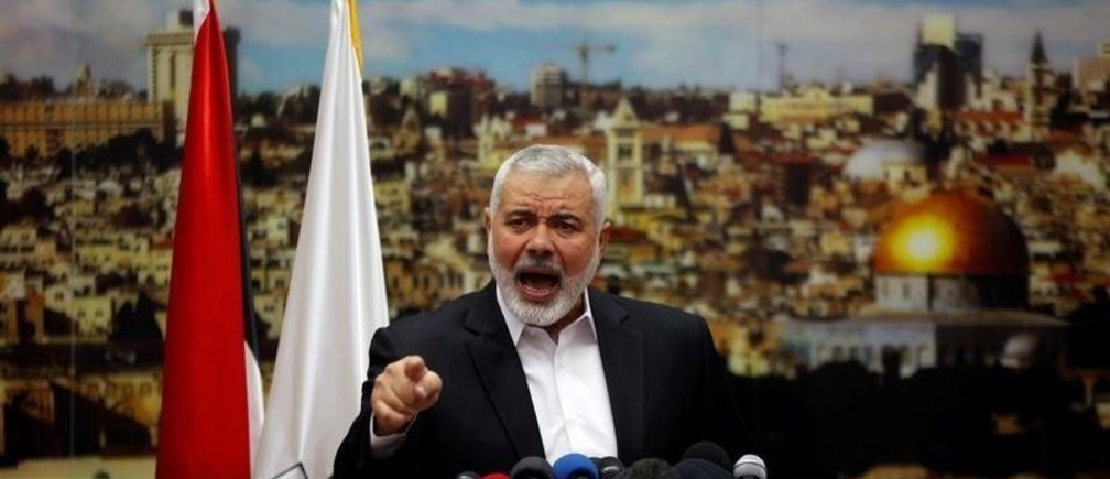 Hamas Chief Ismail Haniyeh gestures as he delivers a speech over U.S. President Donald Trump's decision to recognize Jerusalem as the capital of Israel, in Gaza City December 7, 2017. REUTERS/Mohammed Salem - RC17A999FFD0