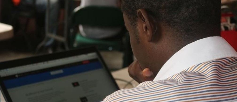 Young startup promoters work on their computers in New Bonako village, Cameroon March 28, 2017 2017. Picture taken March 28, 2017. REUTERS/Stringer