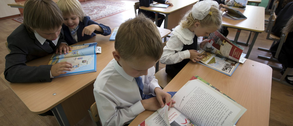 Children, going to the first grade, gather in a classroom after an event marking the start of another school year in Minsk, Belarus, August 31, 2015.