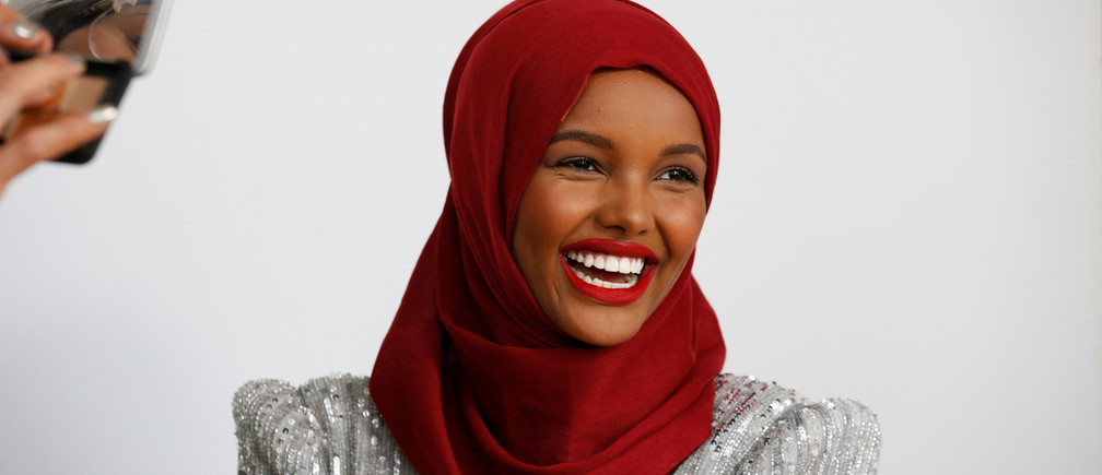 Fashion model and former refugee Halima Aden, who is breaking boundaries as the first hijab wearing model gracing magazine covers and walking in high profile runway shows has her makeup applied during a shoot at a studio in New York City, U.S .August 28, 2017. Photo taken August 28, 2017.  REUTERS/Brendan McDermid - RC11EA18CF80
