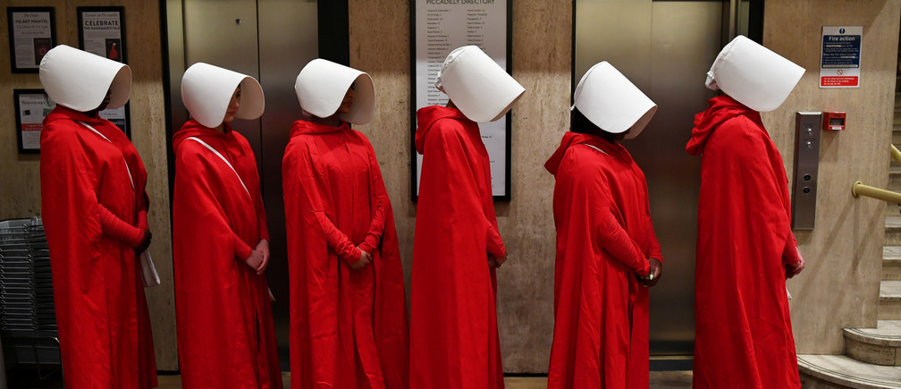 "People dressed up as characters from Margaret Atwood's ""The Handmaid's Tale"" queue to get a copy of her new novel ""The Testaments"" at Waterstones bookshop in London, Britain, September 9, 2019. REUTERS/Dylan Martinez     TPX IMAGES OF THE DAY - RC1A917F7F90"