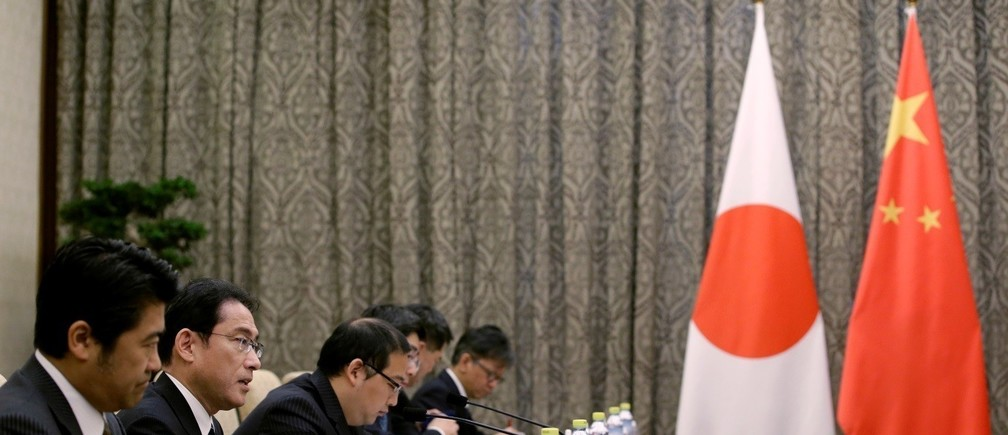 Japanese Foreign Minister Fumio Kishida (2nd L) talks to China's Foreign Minister Wang Yi (not in picture) during a meeting at Diaoyutai State Guesthouse, in Beijing, China, April 30, 2016.
