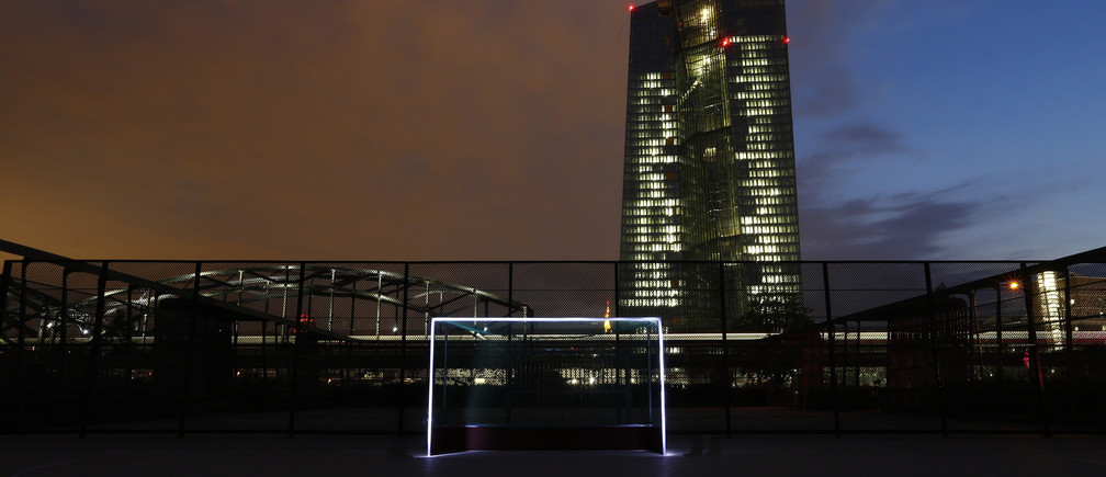 A photograph taken using long exposure shows a goalpost which has been illuminated with torches at a leisure facility in front of the European Central Bank (ECB) headquarters in Frankfurt June 1, 2014. The 2014 Brazil World Cup opens on June 12 and fans around the globe are gearing up for the big tournament. But soccer lovers are not only preparing to watch the world's best professional players battle it out on the pitch; they are also out there kicking a ball about themselves. Reuters photographers on every continent, in countries from China to the Czech Republic, went out to capture images of soccer goalposts used by players to practise the 'beautiful game'. Picture taken June 1, 2014. REUTERS/Ralph Orlowski (GERMANY - Tags: SPORT SOCCER WORLD CUP SOCIETY)ATTENTION EDITORS: PICTURE 24 OF 60 FOR PACKAGE '2014 WORLD CUP - AROUND THE WORLD IN 60 GOALS'TO FIND ALL IMAGES SEARCH 'GLOBAL GOALPOSTS' - GM1EA690J9J01