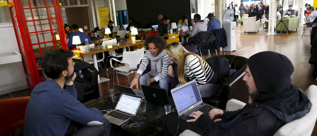 """Participants of the """"Start Up Chile"""" program work at their headquarters in Santiago, August 10, 2015. Drawn in by equity-free financing and promises of hands-on mentorship, dozens of female entrepreneurs will head to Chile in the coming weeks to participate in what the government says is the world's first state-run start-up program aimed exclusively at women. It's not the first attempt by Chile to catalyze its start-up scene. Since 2010, the government has awarded over $40 million in seed capital to thousands of up-and-coming innovators, according to its own statistics. Picture taken August 10, 2015. REUTERS/Ivan Alvarado - GF10000174915"""