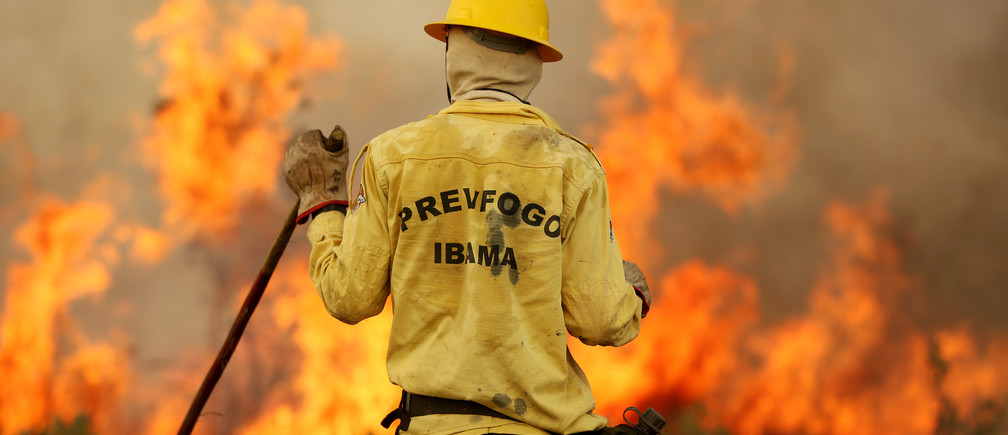 A Brazilian Institute for the Environment and Renewable Natural Resources (IBAMA) fire brigade member is seen as he attempts to control hot points during a fire at Tenharim Marmelos Indigenous Land, Amazonas state, Brazil, September 15, 2019. Picture taken September 15, 2019. REUTERS/Bruno Kelly - RC1683941F20