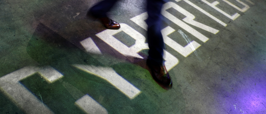 "A visitor steps over the projected word, ""Cybertech"" at the Cybertech 2019 conference in Tel Aviv, Israel January 29, 2019. REUTERS/Amir Cohen - RC1336A6ADB0"