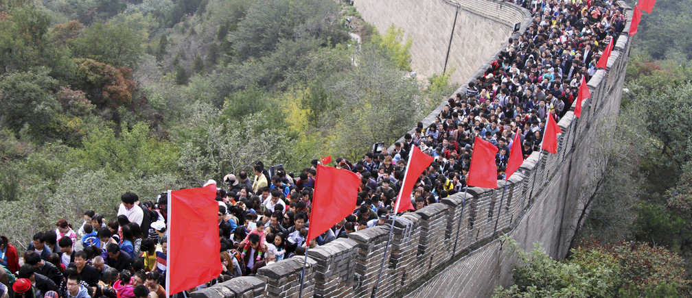 "Tourists visit the Great Wall on the third day of the seven-day national day holiday, on the outskirts of Beijing, October 3, 2014. The national day holiday, known by many Chinese as ""the Golden Week"" for travel, started on October 1 this year, celebrating the 65th anniversary of the founding of the People's Republic of China. According to a prediction by the China Tourism Academy, a total of 480 million trips are expected to be made by travellers within these seven days, Xinhua News Agency reported. Picture taken October 3, 2014. REUTERS/Stringer (CHINA - Tags: TRAVEL SOCIETY ANNIVERSARY) CHINA OUT. NO COMMERCIAL OR EDITORIAL SALES IN CHINA - RTR48XW4"