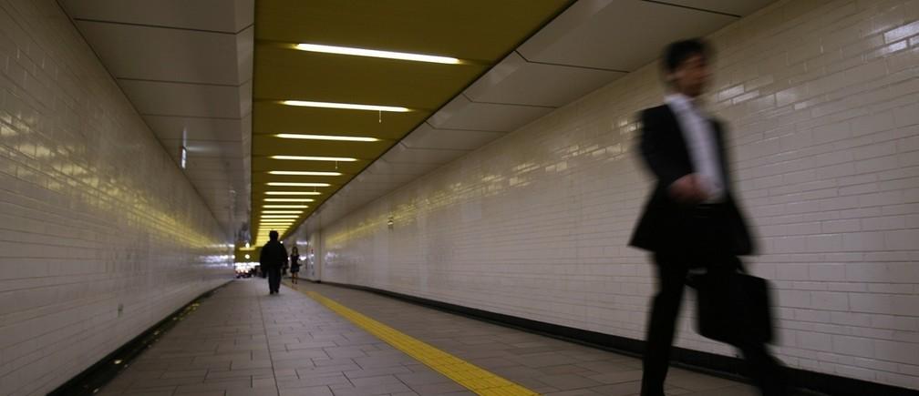 A businessman walks through a station in Tokyo
