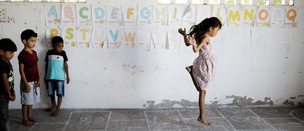 (L-R) Adriel, 6, Matheus 6, and Rian, 5, look at her classmate Michelly as they play during class at Sao Jose school in Morro Do Veridiano, Belagua Municipality, Maranhao state, Brazil, October 10, 2018. Picture taken October 10, 2018. According to the 2015 National Household Sample Survey (Pnad), 2.8 million children and adolescents aged 4 to 17 are out of school. More than half (53 percent) come from households whose income per capita does not exceed half the minimum wage, a value of 477 reais (~$123 USD). While Brazil is in the top ten economies in the world, there are still millions of people in the northeast of the country who are in extreme poverty. REUTERS/Nacho Doce     TPX IMAGES OF THE DAY - RC19675F85D0