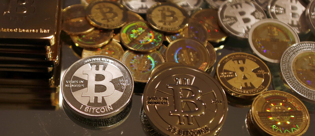 Bitcoins created by enthusiast Mike Caldwell are seen in a photo illustration at his office in Sandy, Utah, September 17, 2013.