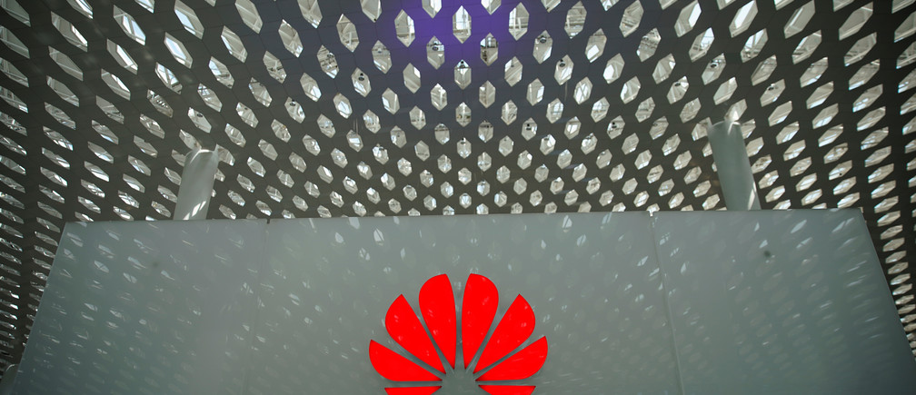 A Huawei company logo is seen at the Shenzhen International Airport in Shenzhen in Shenzhen, Guangdong province, China June 17, 2019. REUTERS/Aly Song - RC1C5C27D080