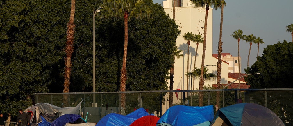 Tents and tarps are seen on the sidewalk of a freeway overpass home to hundreds of homeless living on the streets of Los Angeles, California, U.S., January 22, 2020.     REUTERS/Mike Blake - RC2GLE9XSEMR