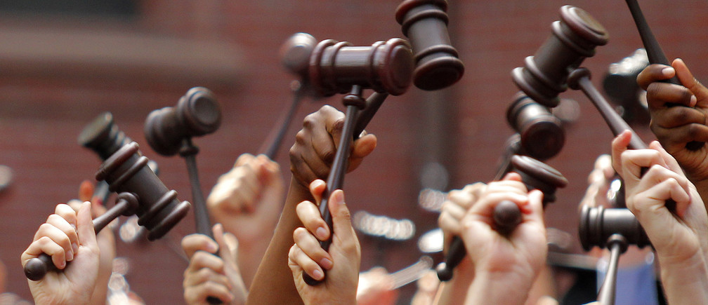 Graduates from the law school hold up gavels in celebration during their commencement at Harvard University in Cambridge, Massachusetts May 27, 2010.     REUTERS/Adam Hunger (UNITED STATES - Tags: EDUCATION IMAGES OF THE DAY) - GM1E65S078Q01