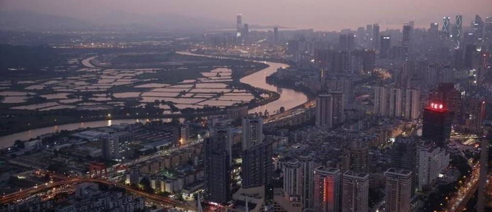 "Shenzhen River, the border river that divides Hong Kong (left) and Shenzhen is seen from Shenzhen, China, October 22, 2019. REUTERS/Tyrone Siu      SEARCH ""HONG KONG-SHENZHEN BORDER"" FOR THIS STORY. SEARCH ""WIDER IMAGE"" FOR ALL STORIES. TPX IMAGES OF THE DAY - RC28AE9FECES"