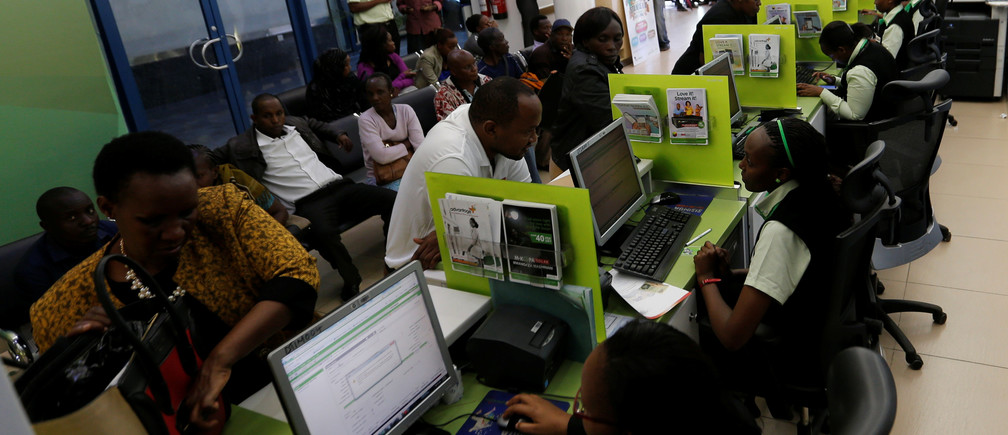 Employees serve customers inside a mobile phone care centre operated by Kenyan's telecom operator Safaricom in the central business district of Kenya's capital Nairobi, May 11, 2016.