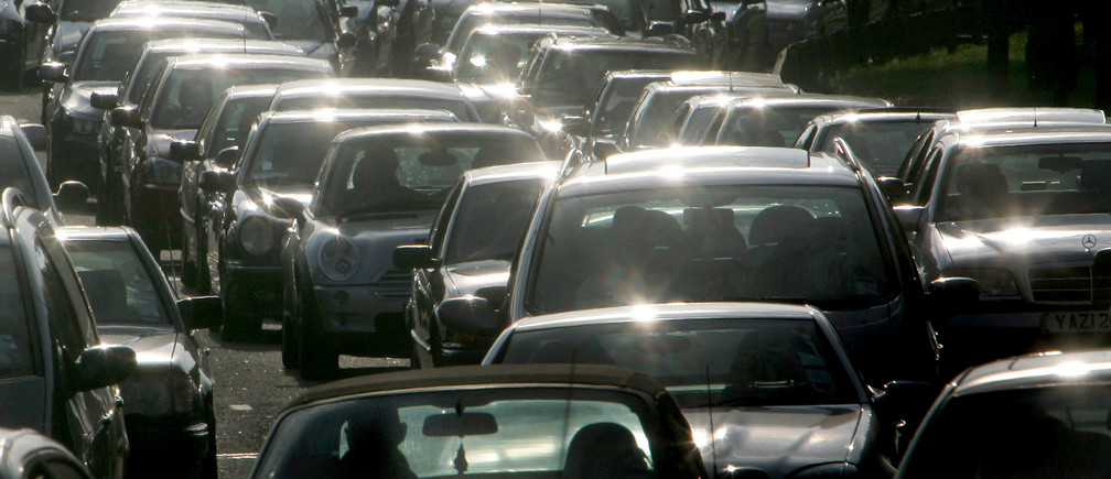 Drivers queue during evening rush hour on the M4 motorway, in west London, July 20, 2004. Britain's Transport Secretary Alistair Darling unveiled new government transport plans for the next 10 years on Tuesday, announcing car tax and fuel duty could be scrapped and replaced with a system of road charging. NO RIGHTS CLEARANCES OR PERMISSIONS ARE REQUIRED FOR THIS IMAGE