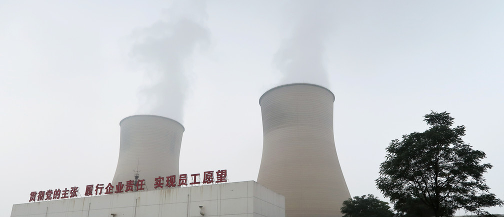 Smoke is seen from cooling towers of a China Energy ultra-low emission coal-fired power plant during a media tour, in Sanhe, Hebei province, China July 18, 2019. Picture taken July 18, 2019.  REUTERS/Shivani Singh - RC121189B1D0