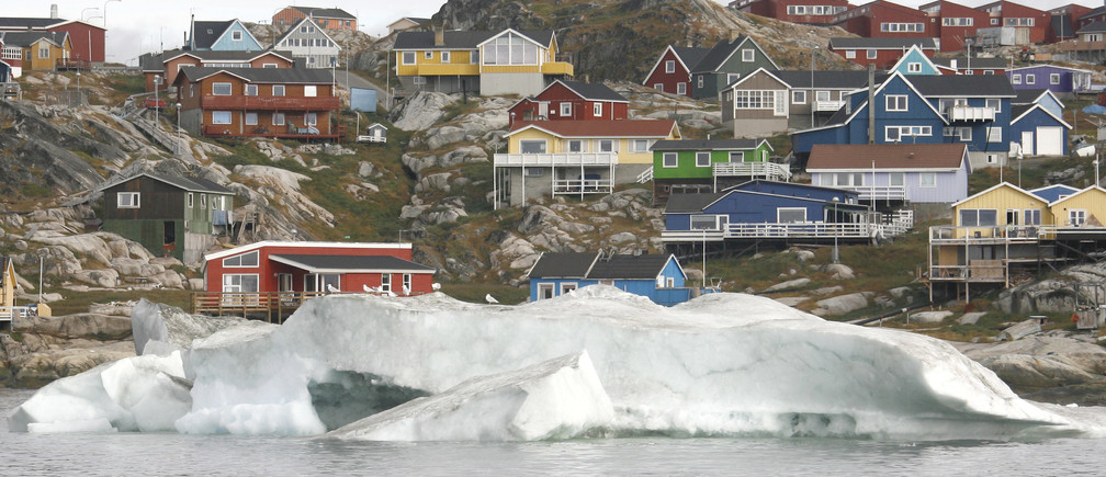The small town of Ilulissat in Greenland is seen in this photo taken August 16, 2007. New York, Boston and other cities on North America's northeast coast could face a rise in sea level this century that would exceed forecasts for the rest of the planet if Greenland's ice sheet keeps melting as fast as it is now, researchers said May 27, 2009. Sea levels off the northeast coast of North America could rise by 12 to 20 inches more than other coastal areas if the Greenland glacier-melt continues to accelerate at its present pace, the researchers reported.   REUTERS/Michael Kappeler/Pool/Files  (GREENLAND ENVIRONMENT SOCIETY) - GM1E55S0BZK01
