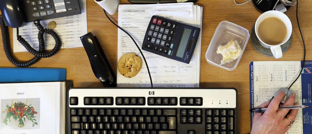 A cup of tea is seen on an office table in Cornwall.
