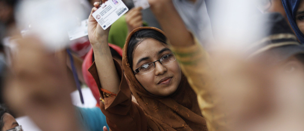Students at Bangladesh University of Engineering and Technology (BUET) show their identity cards as they take part in a protest following a silent procession to demand the removal of the university's Vice Chancellor and Pro-Vice Chancellor in Dhaka July 15, 2012. Bangladesh aims to get the full picture on corruption in the education ministry by installing closed-circuit television cameras in its key offices in the capital to catch bureaucrats taking bribes for services. Picture taken on July 15, 2012. REUTERS/Andrew Biraj (BANGLADESH - Tags: EDUCATION CIVIL UNREST) - GM1E87H1RCW01