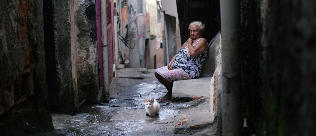 Maria das Neves, 76, is pictured in Alemao slums complex during the coronavirus disease (COVID-19) outbreak in Rio de Janeiro, Brazil March 22, 2020. Picture taken March 22, 2020