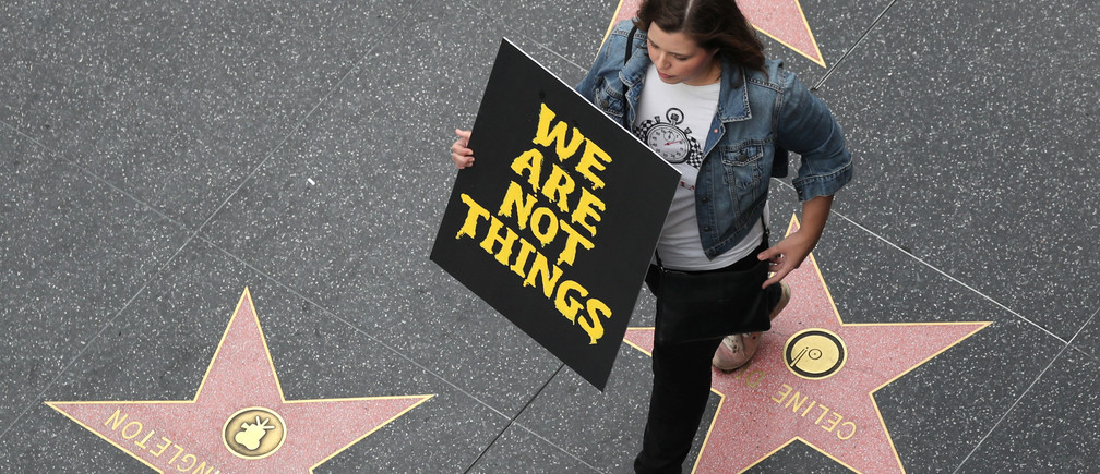 A demonstrator takes part in a #MeToo protest march for survivors of sexual assault and their supporters on the Hollywood Walk of Fame in Hollywood, Los Angeles, California U.S. November 12, 2017. REUTERS/Lucy Nicholson - RC1CADF83F40