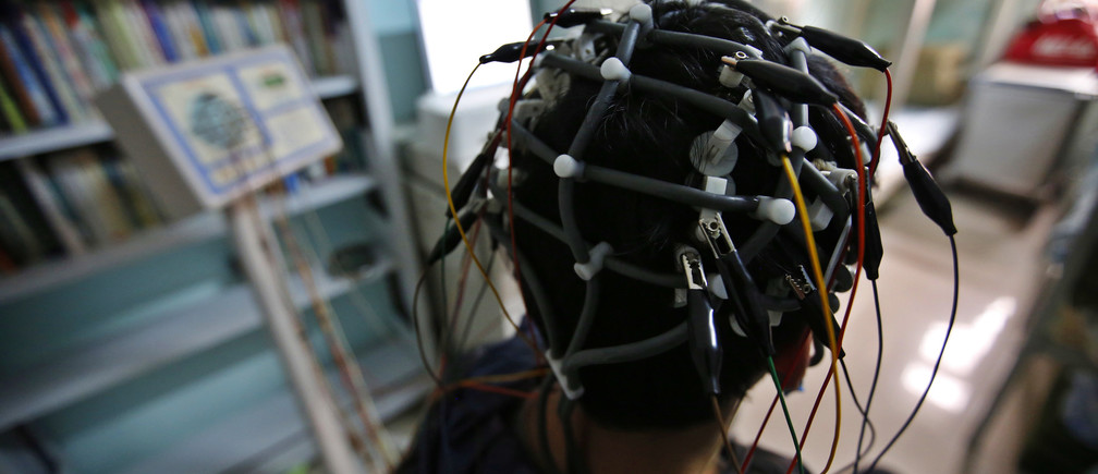 A boy who was addicted to the internet, has his brain scanned for research purposes at Daxing Internet Addiction Treatment Center in Beijing February 22, 2014.  As growing numbers of young people in China immerse themselves in the cyber world, spending hours playing games online, worried parents are increasingly turning to boot camps to crush addiction. Military-style boot camps, designed to wean young people off their addiction to the internet, number as many as 250 in China alone. Picture taken February 22, 2014. REUTERS/Kim Kyung-Hoon (CHINA - Tags: SOCIETY)ATTENTION EDITORS - PICTURE 21 OF 33 FOR PACKAGE 'CURING CHINA'S INTERNET ADDICTS'TO FIND ALL IMAGES SEARCH 'INTERNET BOOT CAMP' - RTR3WL7Y