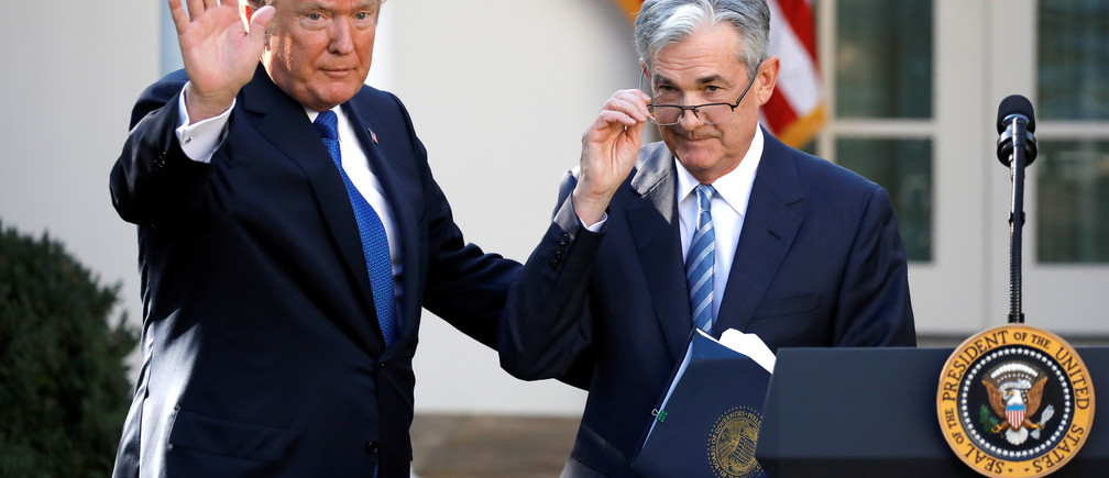 U.S. President Donald Trump gestures with Jerome Powell, his nominee to become chairman of the U.S. Federal Reserve at the White House in Washington, U.S., November 2, 2017. REUTERS/Carlos Barria     TPX IMAGES OF THE DAY - RC16731B2040