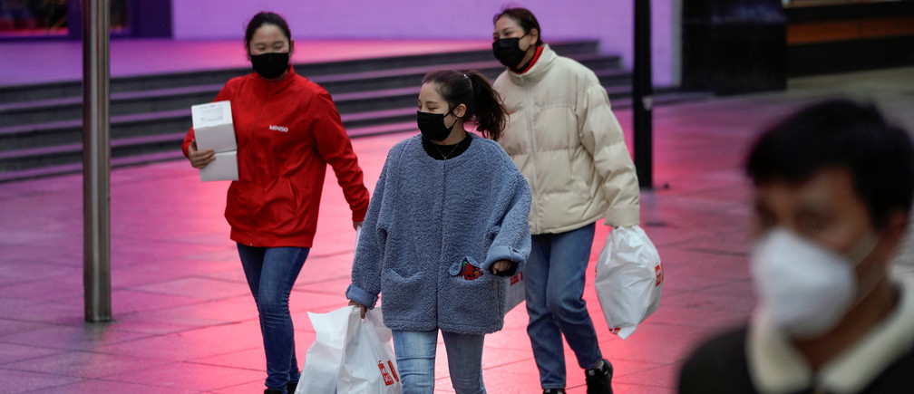 People wear masks at a main shopping area as the country is hit by an outbreak of the new coronavirus in downtown Shanghai, China February 21, 2020. REUTERS/Aly Song - RC205F9RZ74I