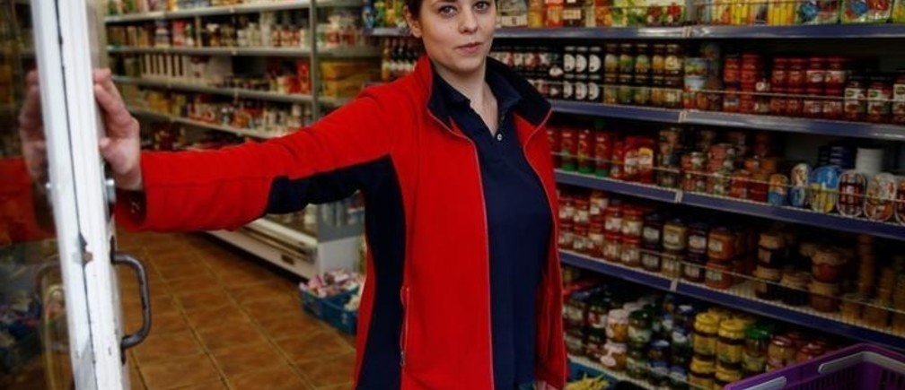 "Monika Cyrek, a Polish national who works in a grocery store run by her mother that sells mostly Polish products, poses for a photograph in Walton-on-Thames, Britain June 18, 2016. ""If we're not wanted here, probably a lot of people will leave and try other places,"" said Cyrek. Picture taken June 18, 2016."