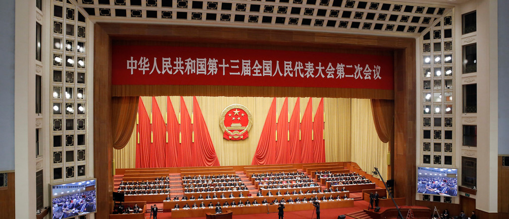 Officials attend the second plenary session of the National People's Congress (NPC) at the Great Hall of the People in Beijing, China March 8, 2019. REUTERS/Thomas Peter - RC17B5347E10