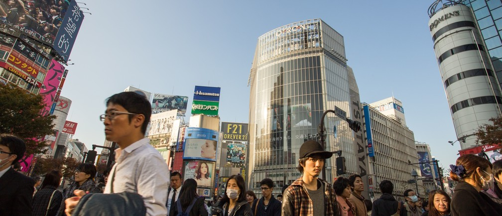 people walking through the streets in Tokyo with buildings behind them, one of the top seven established world cities