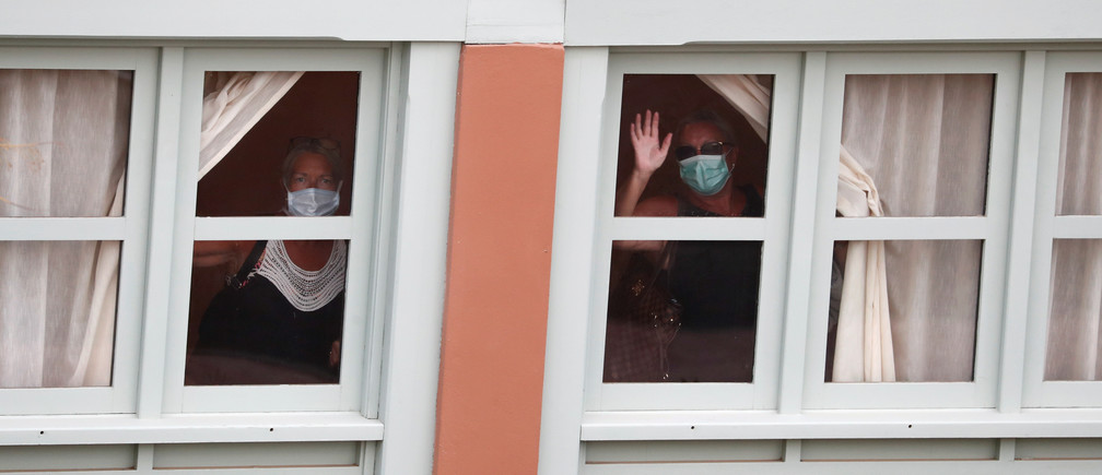 Guests peer out from a window at H10 Costa Adeje Palace hotel, which is on lockdown after the novel coronavirus has been confirmed in Adeje, in the Spanish Canary Island of Tenerife, Spain, March Coronavirus china virus health healthcare who world health organization disease deaths pandemic epidemic worries concerns Health virus contagious contagion viruses diseases disease lab laboratory doctor health dr nurse medical medicine drugs vaccines vaccinations inoculations technology testing test medicinal biotechnology biotech biology chemistry physics microscope research influenza flu cold common cold bug risk symptomes respiratory china iran italy europe asia america south america north washing hands wash hands coughs sneezes spread spreading precaution precautions health warning covid 19 cov SARS 2019ncov wuhan sarscow wuhanpneumonia  pneumonia outbreak patients unhealthy fatality mortality elderly old elder age serious death deathly deadly