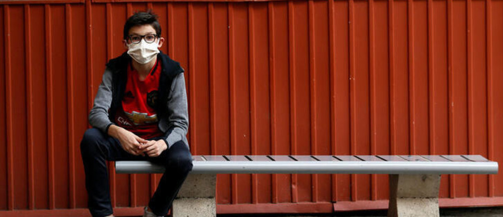 A student, wearing protective face mask, sits in the courtyard at the College Sasserno school during its reopening in Nice as a small part of French shoolchildren head back to their schools with new rules and social distancing during the outbreak of the coronavirus disease (COVID-19) in France, May 19, 2020.