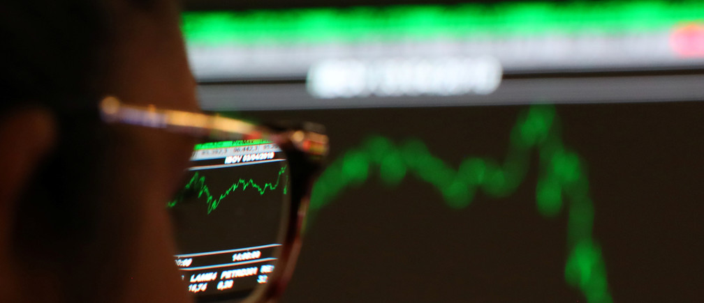 A woman looks at an electronic board showing the recent fluctuations of market indices on the floor of Brazil's B3 Stock Exchange in Sao Paulo, Brazil, April 3, 2019. Picture taken April 3, 2019. REUTERS/Amanda Perobelli - RC157ABDC690