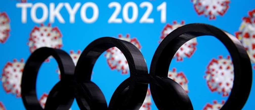 "A 3D printed Olympics logo is seen in front of displayed  ""Tokyo 2021""  words in this illustration taken March 24, 2020. REUTERS/Dado Ruvic - RC2DQF9V5DX2"