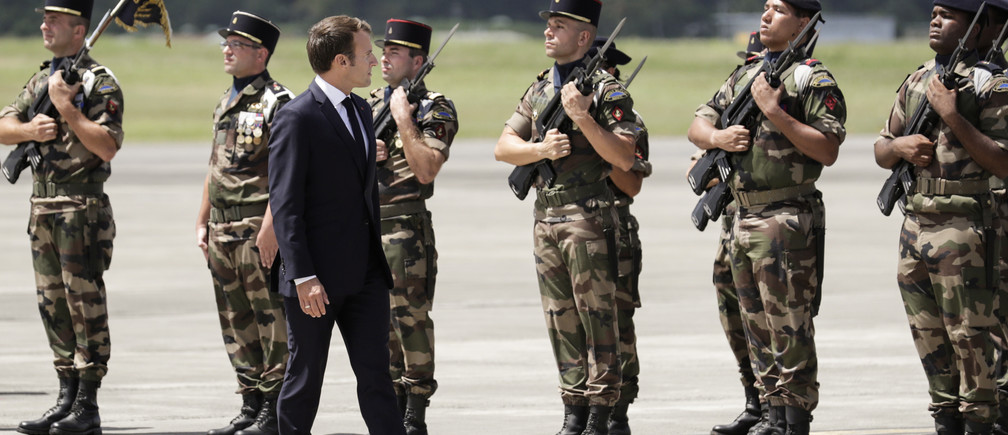 French President Emmanuel Macron reviews troops upon his arrival at Remy de Haenen airport on the Caribbean island of Saint Barthelemy, France September 28, 2018. Thomas Samson/Pool via REUTERS - RC1573265B20
