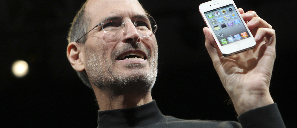 Apple CEO Steve Jobs poses with the new iPhone 4 during the Apple Worldwide Developers Conference in San Francisco, California, June 7, 2010