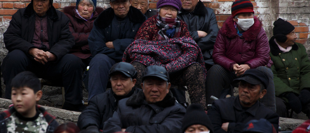 Locals and retired workers watch a Chinese opera performance that Xinyuan Steel put on to mark the end of Chinese New Year festivities in Anyang, Henan province, China, February 19, 2019.  Picture taken February 19, 2019.  REUTERS/Thomas Peter - RC1D639C3120