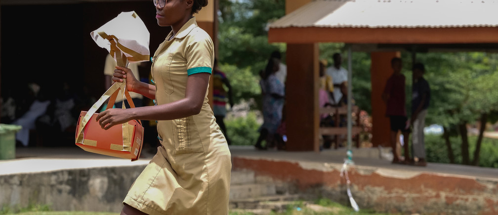 A nurse carries a Zipline vaccine delivery in Ghana, April 23, 2019. Zipline drones, supported by Gavi and the UPS Foundation, cut the time taken to deliver lifesaving medical supplies from hours to minutes. Gavi/2019/Tony Noel via REUTERS   ATTENTION EDITORS - THIS IMAGE HAS BEEN SUPPLIED BY A THIRD PARTY. MANDATORY CREDIT