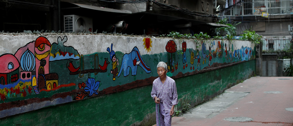A woman walks at the traditional neighbourhood of Yuexiu in Guanghzou, China, September 8, 2019. REUTERS/Jorge Silva - RC1240E47E80