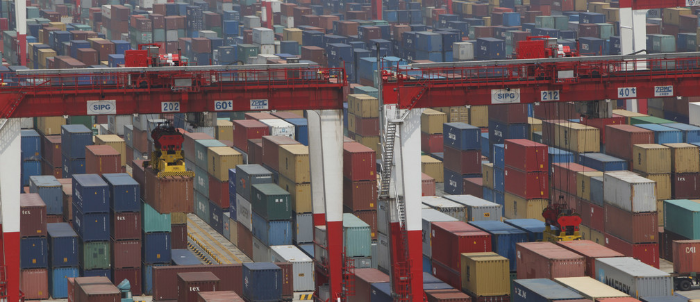 A general view of a shipping container area at the Yangshan Port of Shanghai May 11, 2012. China risks a fresh downturn in demand for goods from its massive factory sector, with weaker than expected exports and stalling headline import growth signalling that government spending is the crucial factor keeping the economy moving. REUTERS/Aly Song (CHINA - Tags: BUSINESS) - GM1E85B13H401