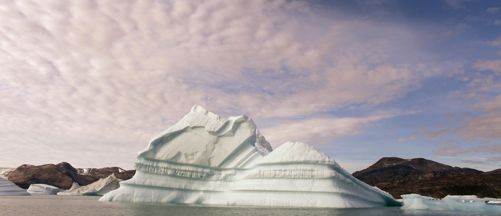 An iceberg floats in a fjord near the town of Kulusuk in eastern Greenland August 2, 2009.