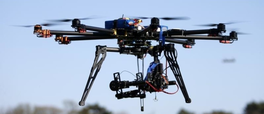 An octocopter (a drone with eight rotors) flies during the 4th Intergalactic Meeting of Phantom's Pilots (MIPP) in an open secure area in the Bois de Boulogne, western Paris, March 16, 2014. Drone operators in France are required to complete a training course to fly an unmanned aerial vehicle and also receive written approval for flights in urban areas. Picture taken March 16, 2014.