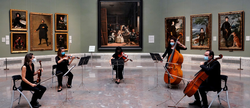 Musicians perfom next to Spanish artist Diego Velazquez's paintings as the Prado museum reopens amid the coronavirus disease (COVID-19) outbreak, in Madrid, Spain, June 6, 2020.